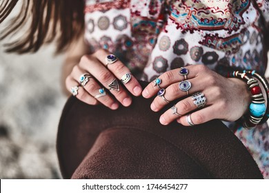 Gorgeous stylish boho chic woman wearing silver rings. Fashionable indian hippie gypsy bohemian outfit with jewelry accessories details