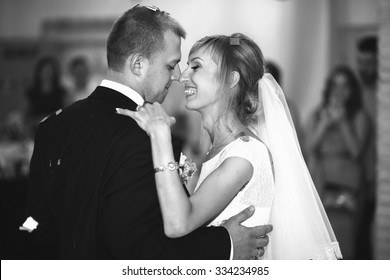 gorgeous stylish happy bride and groom performing their emotional first dance, wedding in a restaurant
