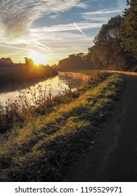Gorgeous sunrise over the river Dyle near Mechelen, Belgium, during an early misty morning in September