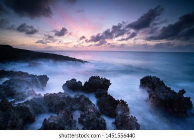 Gorgeous sunrise viewed from the lava rock found along the Caribbean coast. In the foreground one can see a gorgeous set of tide pools that reflect the last remaining sunlight of the day.
