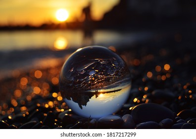 gorgeous sunset over the sea seen through the eye of the lensball