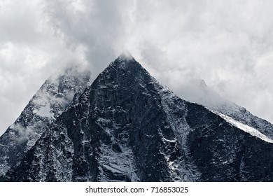 Gorgeous Swiss mountain with it's summit in the clouds and snow on it's face