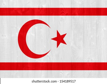 gorgeous Turkish Republic of Northern Cyprus flag painted on a wood plank texture