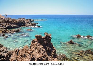 Gorgeous turquoise rocky bay in Playa de San Juan on Tenerife, Spain