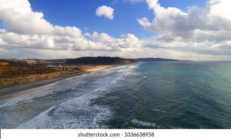Gorgeous, unique, aerial view, cloudscape & beachscape, of coastline & surf, & the pristine Pacific Ocean in Torrey Pines, Carmel valley, Del Mar, & La Jolla in San Diego county California