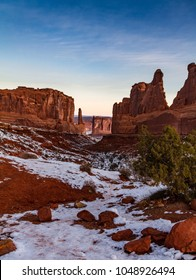 "Gorgeous vertical sunrise shot of ""Park Avenue"" in Arches National Park in the winter with snow in Moab, Utah USA."