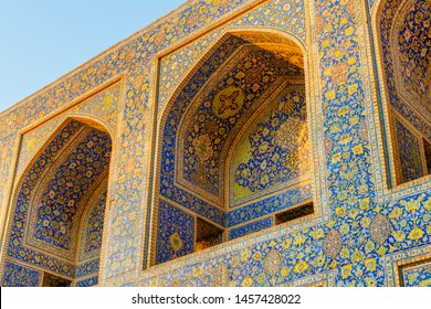 Gorgeous view of arch niches covered with colorful mosaic tiles at courtyard of the Shah Mosque (Imam Mosque) in Isfahan, Iran. Wonderful Persian exterior of the Muslim place. Islamic architecture.
