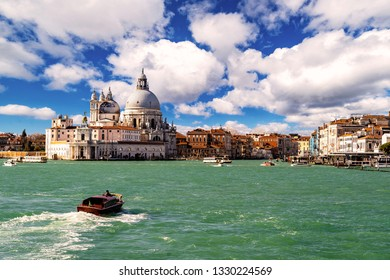 Gorgeous view of the Grand Canal and Basilica Santa Maria della Salute during a beautiful day with interesting clouds, Venice, Italy.