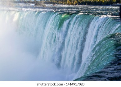 Gorgeous view of Niagara Falls landscape.Waves rumbling against the rocky shore.