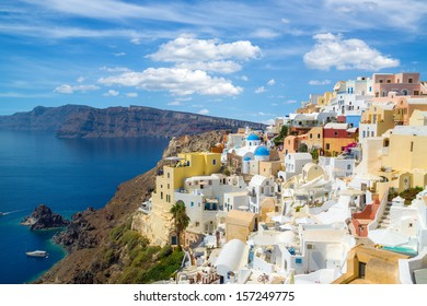 Gorgeous view of the Oia village and caldera under dramatic clouds, Oia, Santorini island, Greece