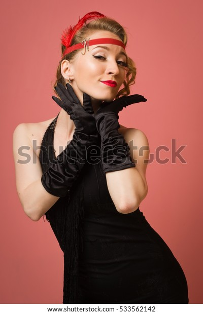 Gorgeous vintage 1920s lady in a black dress with headband