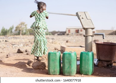 Gorgeous West African Girl Saving Fresh Water for a dehydration concept