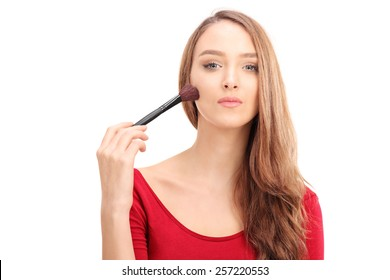 Gorgeous woman applying make-up with a brush isolated on white background