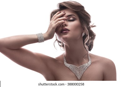 Gorgeous woman with beautiful jewelry on white background