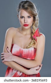 Gorgeous woman beauty portrait with red lipstick, bohemian braids hairstyle and butterfly decor