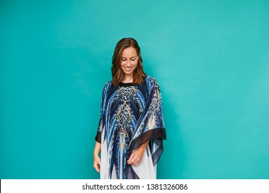 Gorgeous woman in blue kaftan, looking down