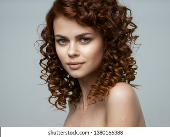 A gorgeous woman with curly hair has an attractive appearance