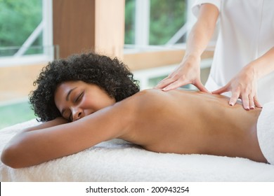 Gorgeous woman enjoying a back massage at the health spa