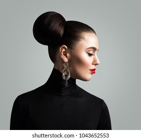 Gorgeous Woman with Hair Bun Hairstyle and Eyeliner Makeup. Fashion Beauty Portrait