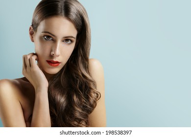 gorgeous woman looking at the camera on the cool background