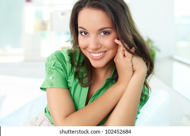 Gorgeous woman looking at camera with smile