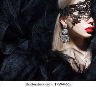 gorgeous woman in mask looking at camera