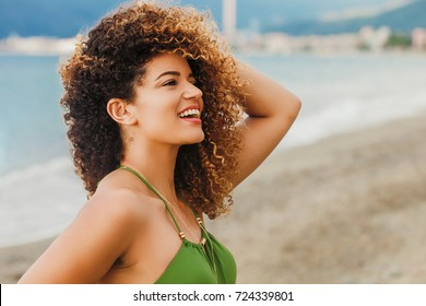 Gorgeous woman portrait smiling on the beach in Summer