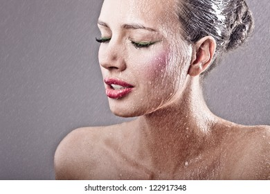 Gorgeous woman with rain on face