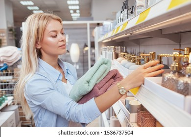 Gorgeous woman shopping homeware at hypermarket, copy space. Housewife buying home goods