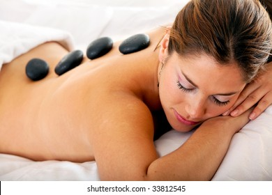 Gorgeous woman at a spa having a hot stones massage