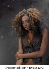 Gorgeous young African American woman with full beautiful lips and wonderful hair against a grunge background