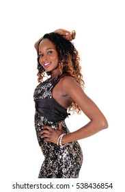 A gorgeous young African American woman with a slim figure standingin profile with one arm on her head, isolated for white background.