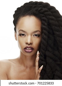 Gorgeous young African American woman with Beautiful twisted hairstyle
