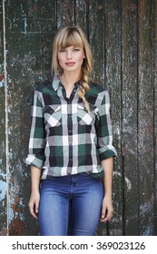 Gorgeous young  blonde woman in checked shirt