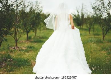Gorgeous  young bride enjoying wedding day. Summertime newlywed.