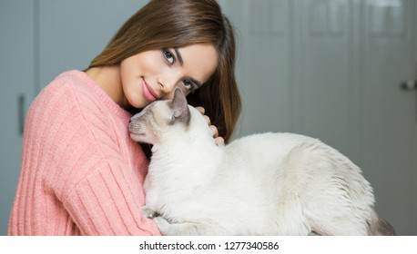 Gorgeous young brunette woman with beautiful cat.