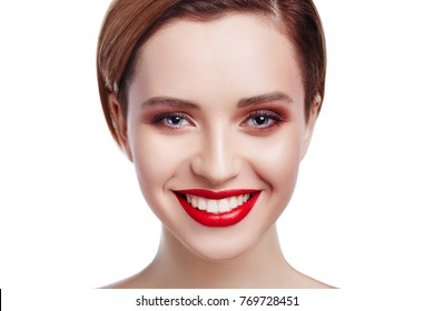 Gorgeous Young Brunette Woman face portrait with clear skin. Beauty Model Girl with blue eyes, perfect make-up, red full  lips. Girl smiling with perfect white teeth. Isolated on white background.
