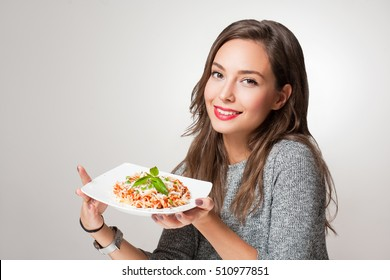 Gorgeous young brunette woman having Italian food.