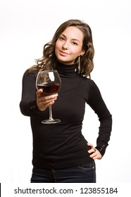 Gorgeous young brunette woman tasting dark red wine.
