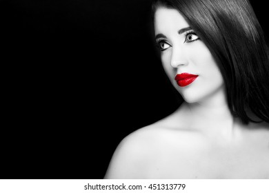 Gorgeous young woman with long eyelashes and red lips. Perfect makeup.