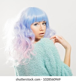 Gorgeous young woman with pastel hair in fuzzy sweater. Closeup studio portrait, medium retouch.