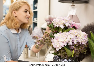 Gorgeous young woman shopping for flowers at the local housewares store flower shop florist decor decorations interior design beauty femininity consumerism buying floral retail customer discount sales