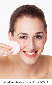 gorgeous young woman smiling in taking care of her face for fresh healthy skincare on white background