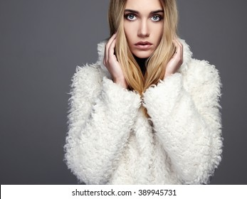 Gorgeous young woman in winter fashion wearing a fur.beautiful blond hair model girl