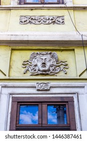 A Gorgon head with hair made of snakes, decoration of an old building in Cluj-Napoca, Transylvania, Romania, Piata Avram Iancu or Avram Iancu Square, architectural detail