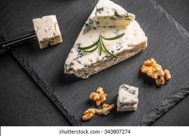 Gorgonzola cheese on black background