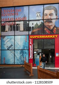 Gori, Georgia - December 1, 2016 :  Portrait of the Soviet dictator Joseph Stalin ( born in Gori ) on the wall of a local grocery store