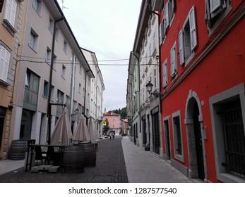 GORIZIA, FRIULI-VENEZIA GIULIA, ITALIA - AUGUST, 17TH, 2015: Perspective of a typical nineteenth century street of Gorizia with the cloudy sky