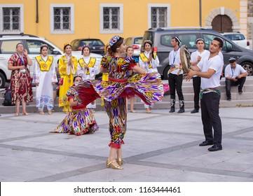 Gorizia, Italy - August 23, 2018: Folk dancers from Tashkent, Uzbekistan performs traditional dance in the town street during the International Folklore Festival in Gorizia, Italy