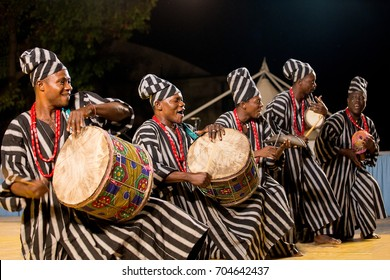 Gorizia, Italy - August 27, 2017: Musician of Benin traditional dance company following the dancers in the town street during the International Folklore Festival in Gorizia, Italy